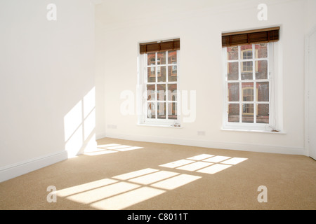 Empty room with light from windows - Stock Photo