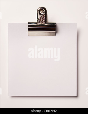 Blank paper and bulldog clip - Stock Photo