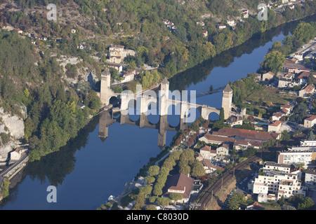 FORTIFIED STONE ARCH BRIDGE (aerial view). 14th century Valentré bridge spanning the Lot River. Dorgogne, Midi-Pyrénées, - Stock Photo