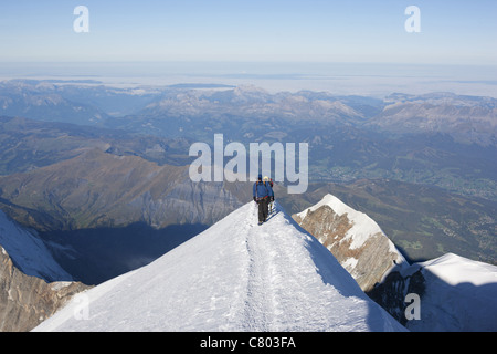 ALPINISTS REACHING THE MONT-BLANC SUMMIT. With an elevation of 4810 meter, it is the highest summit in Europe. France. - Stock Photo