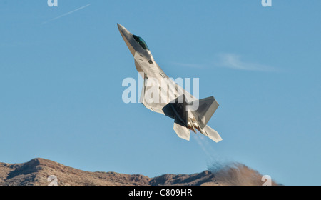 A U.S. Air Force F-22 Raptor takes off from Nellis Air Force Base, Nevada. - Stock Photo