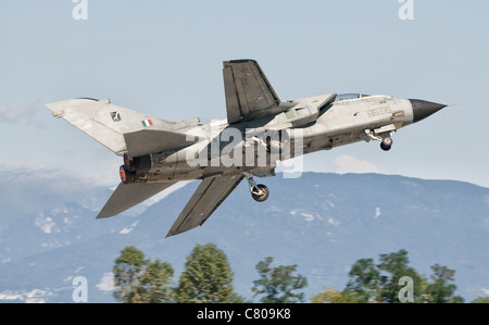 An Italian Air Force Panavia Tornado takes off from Rivolto Air Base in the north of Italy. - Stock Photo