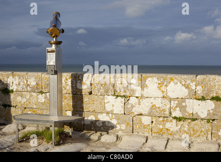 A look out telescope points out toward the Atlanic Ocean in the afternoon light on a pier in île de Ré, France - Stock Photo