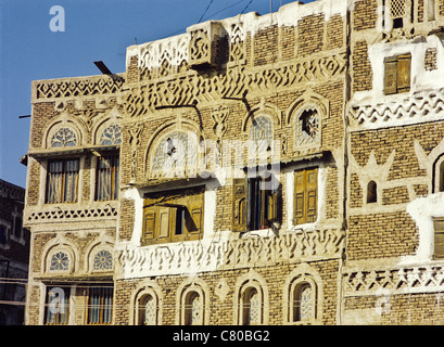 Architectural detail showing tracery windows of a multistory dwelling in the Old City of Sana'a, Yemen - Stock Photo