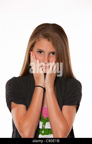 A brown long hair pretty teenage feminine girl isolated against a white background. - Stock Photo