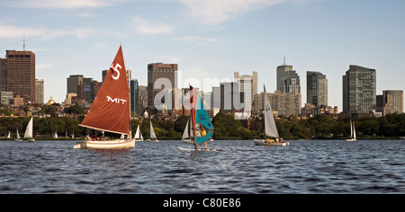 Boaters and windsurfers enjoy a sunny afternoon on the Charles River in Boston. - Stock Photo