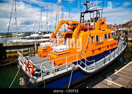 The lifeboat in Yarmouth harbour on the Isle of Wight in England - Stock Photo