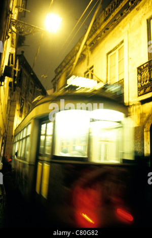 Portugal, Lisbon, Alfama Quarter, Tram at Night. - Stock Photo