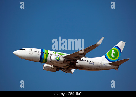 Plane taking off at the airport of Malaga Costa del Sol Andalusia Spain - Stock Photo