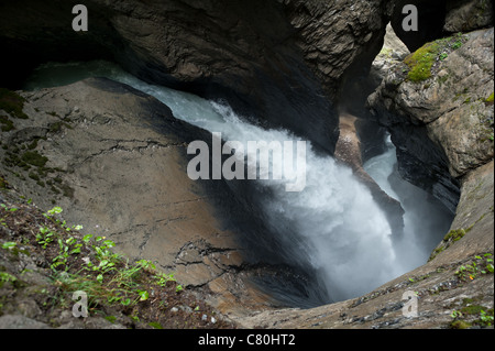 The largest subterranean waterfalls in Europe, the Trummelbach Falls funnel water from the melting glaciers of the - Stock Photo
