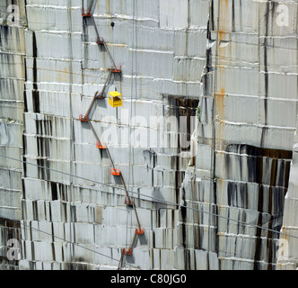 The large wall inside the Quarry at the Rock of Ages Granite quarry in Barre Vermont, by Ano Lobb - Stock Photo