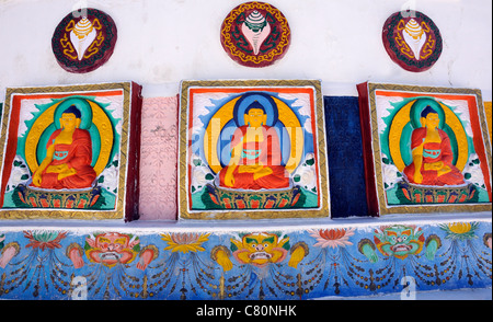 Panels depicting conch shells, the Buddha and monster masks or the face of majesty or  kirtimukha.  Shanti Stupa - Stock Photo