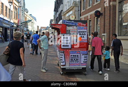 Ipswich Star and East Anglian Daily Times regional newspaper stall or kiosk in Ipswich town centre Suffolk UK - Stock Photo