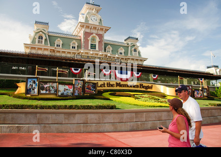 entrance to the magic kingdom florida with the train station in view - Stock Photo