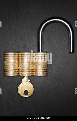 Unlocked Padlock made from pound coins with a gold key inserted, signifying Financial Security - Stock Photo