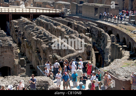 Tourists / tour group inside the ancient Colosseum, Rome, Italy - Stock Photo