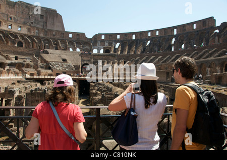 Tourists inside the Colosseum, Rome, Italy, Europe - Stock Photo