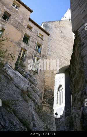 Houses in one of the alleyways running alongside the Palais des Papes / Popes' Palace, Avignon, France - Stock Photo