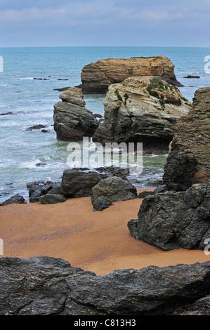 Eroded sea stacks at the Plage des Cinq Pineaux at Saint-Hilaire-de-Riez, La Vendée, Pays de la Loire, France - Stock Photo