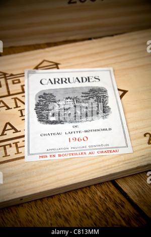Still life with wine label of Carruades de Chateau Lafite-Rothschild, Pauillac, Bordeaux, vintage 1960. - Stock Photo