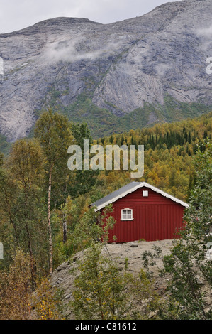 Old wooden traditional Norwegian house in the mountains. - Stock Photo