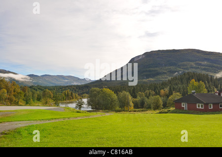 Old wooden traditional Norwegian house in the mountains. Near Korgen, Norway - Stock Photo
