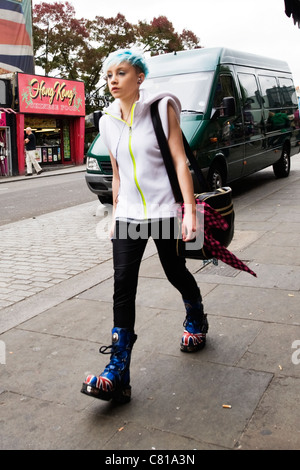 London Camden Town Lock Stables market pretty young punk girl walking with blue hair blue Dr Martens boots with - Stock Photo