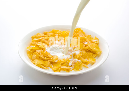 Milk Being Poured Onto Cornflakes - Stock Photo