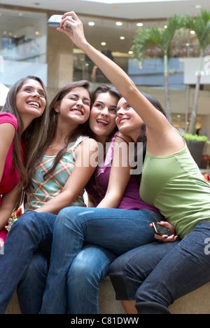Hispanic friends taking self-portrait - Stock Photo