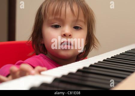 Hispanic girl playing piano