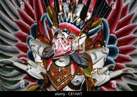 Brightly Painted Garuda Carving From Hindu Mythology - Stock Photo