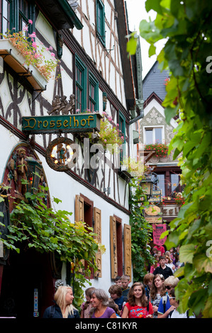 Famous tourist Drosselgasse Street in popular town of Rudesheim on River Rhine in Germany - Stock Photo
