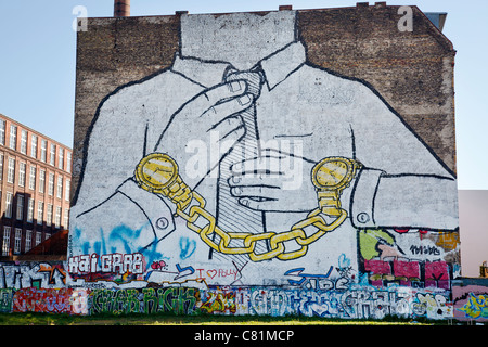 Graffiti by Blu in Cuvrystrasse, Berlin, Germany - Stock Photo