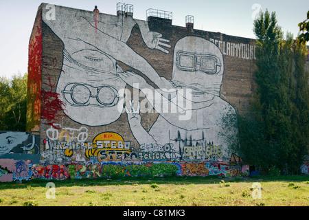 Graffiti by Blu in Cuvrystrasse, Berlin, Germany - Stock Photo