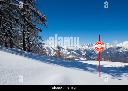 Piste marker and virgin snow, Via Lattea, Sauze d'Oulx, Piemonte, Italy - Stock Photo