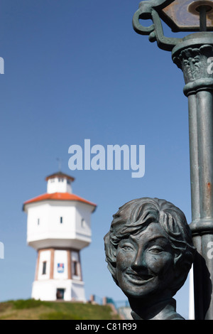 Lale Andersen memorial and the Langeoog's water tower on the German East Frisian Island Langeoog. - Stock Photo