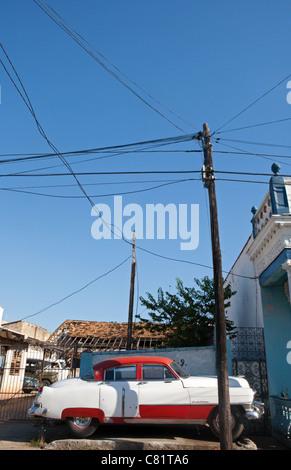 TRINIDAD: CLASSIC VINTAGE AMERICAN CAR PARKED ON CUBAN STREET - Stock Photo