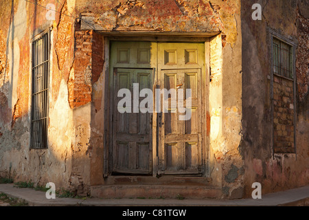 TRINIDAD: DETAIL OF DOORWAY ON STREET CORNER AT DUSK - Stock Photo