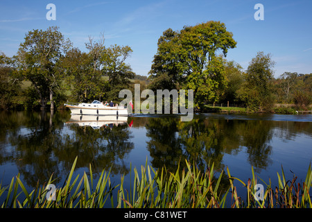 A boat, Cuchulain III, sailing on the River Thames, near Pangbourne, Reading, Berkshire. - Stock Photo
