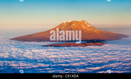 Aerial view of Mount Kilimanjaro lit by the setting sun - Stock Photo