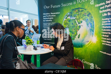 Paris, France,Young Woman at Paris Jobs Fair, Job Seeker Being Interviewed  at Pall Corporation Stall - Stock Photo