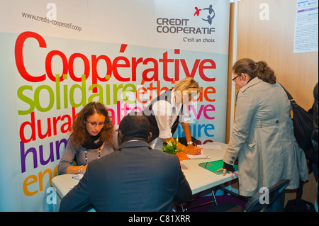 Paris, France, People at Paris Jobs Fair, Job Seeker Being Interviewed at 'Credit Cooperative Banque Corporation' - Stock Photo