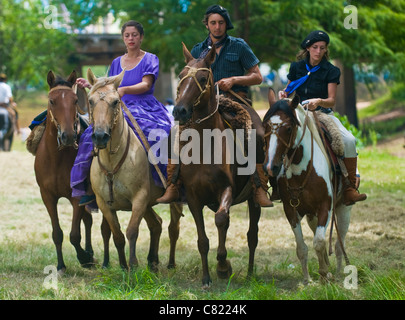 Participants in the annual festival 'Patria Gaucha' - Stock Photo