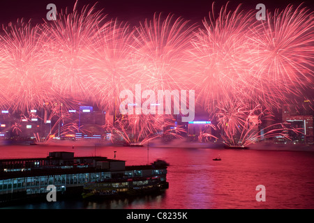 Fireworks over Victoria harbor In Hong Kong on China's National Day celebration, China, on Oct. 1, 2011. - Stock Photo