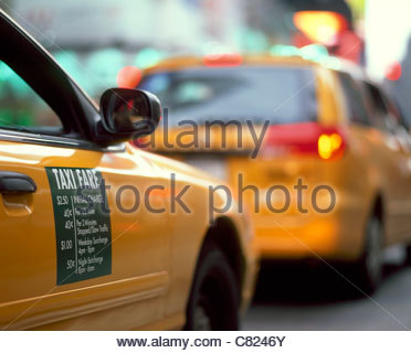 Taxi cabs in Midtown Manhattan, New York, NY - Stock Photo