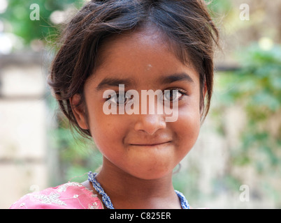 Happy young poor lower caste Indian street girl smiling. Andhra Pradesh, India - Stock Photo