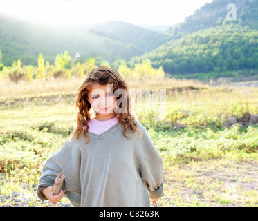 children girl hiking in mountain with father sweater - Stock Photo