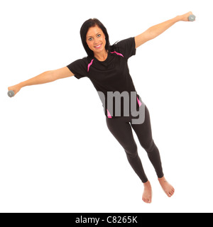 A young female dressed in sports clothes performing a dumbell side deltoid raise exercise - Stock Photo