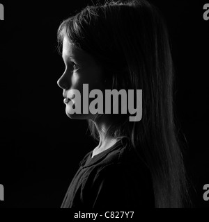Portrait in profile of an eight-year-old girl - Stock Photo