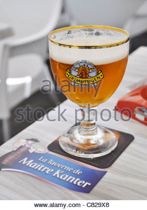 Grimbergen beer served in La Taverne de Maître Kanter - Stock Photo